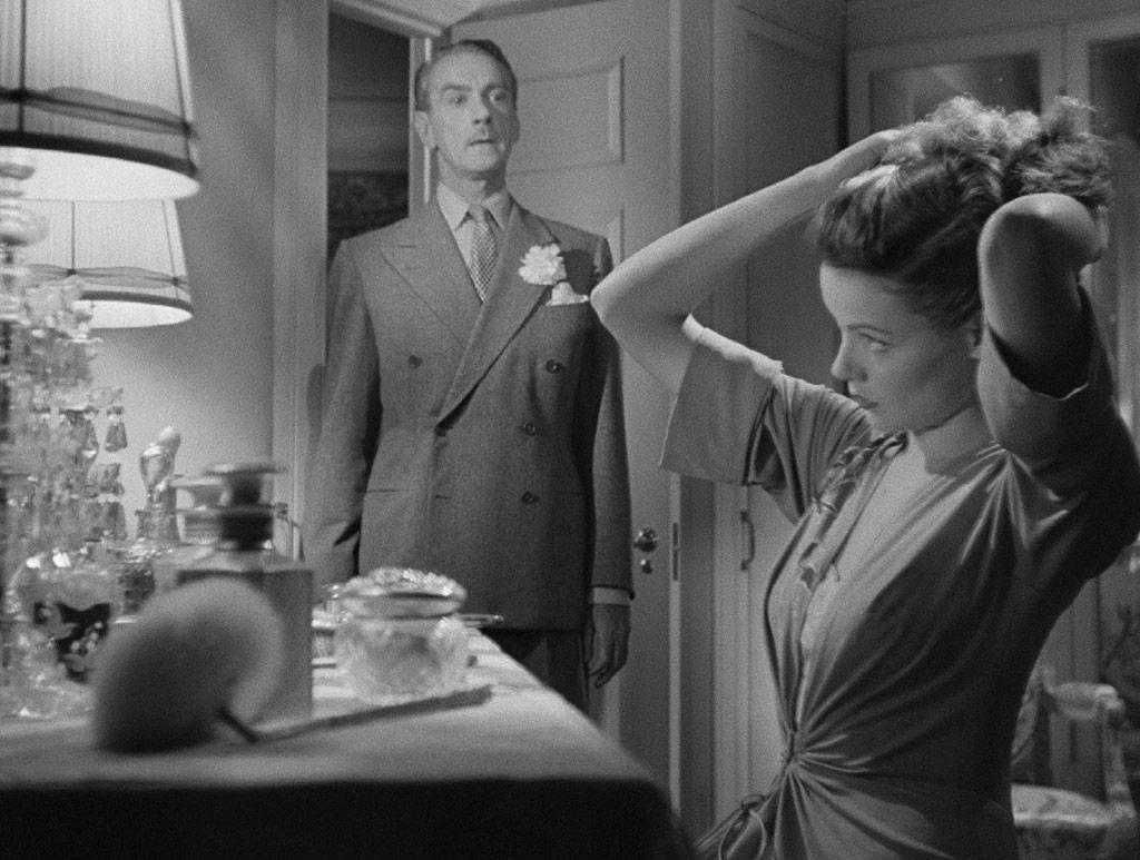 Gene Tierney, Clifton Webb dans Laura