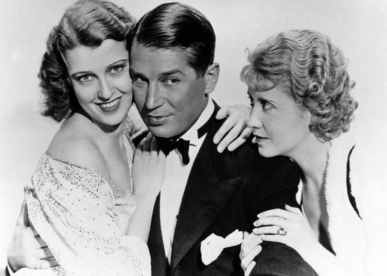 Genevieve Tobin, Jeanette McDonald, Maurice Chevalier dans Une Heure près de toi